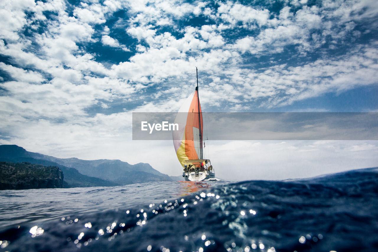Yacht Sailing On Sea Against Cloudy Sky