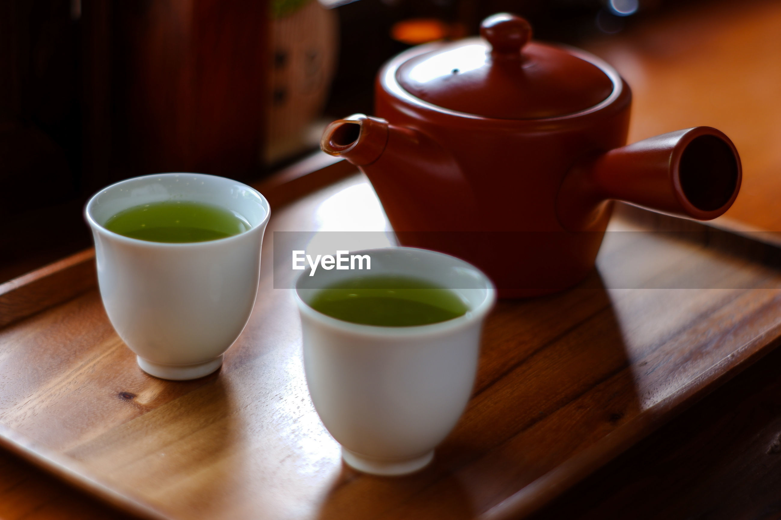 Close-up of matcha tea cups in tray