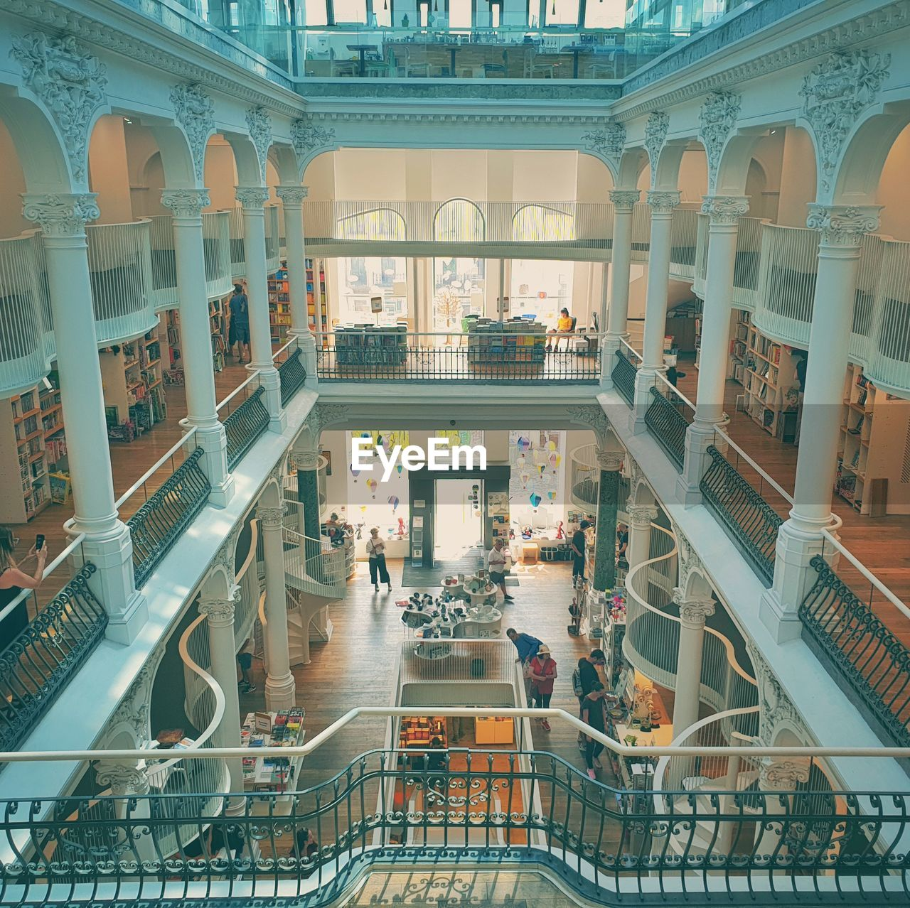 architecture, built structure, group of people, real people, indoors, railing, high angle view, men, incidental people, architectural column, day, large group of people, crowd, building, shopping mall, adult, flooring