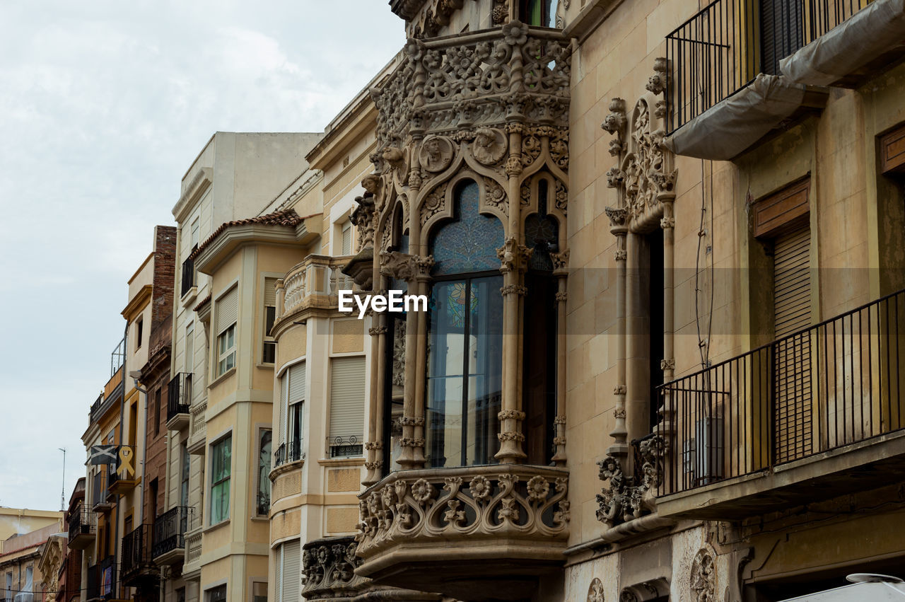 architecture, building exterior, built structure, window, building, low angle view, city, no people, day, sky, balcony, residential district, history, the past, nature, outdoors, cloud - sky, old, art and craft, ornate
