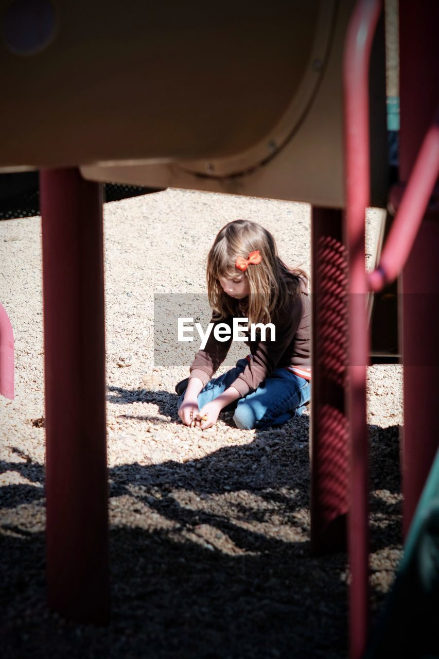 Girl At Playground Seen Through Play Equipment