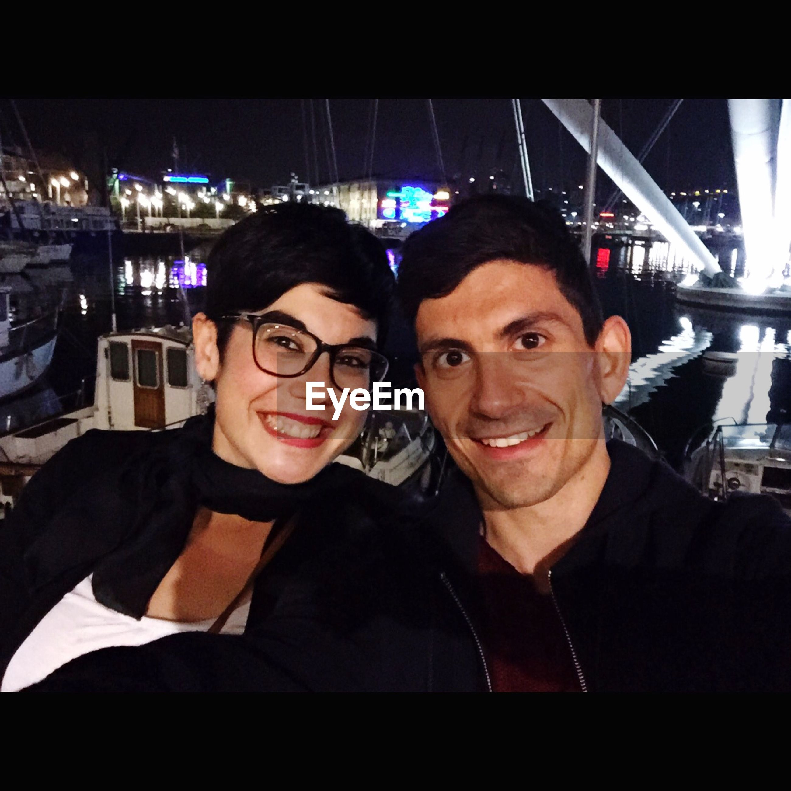 two people, looking at camera, night, portrait, illuminated, smiling, togetherness, young men, love, happiness, young adult, bonding, real people