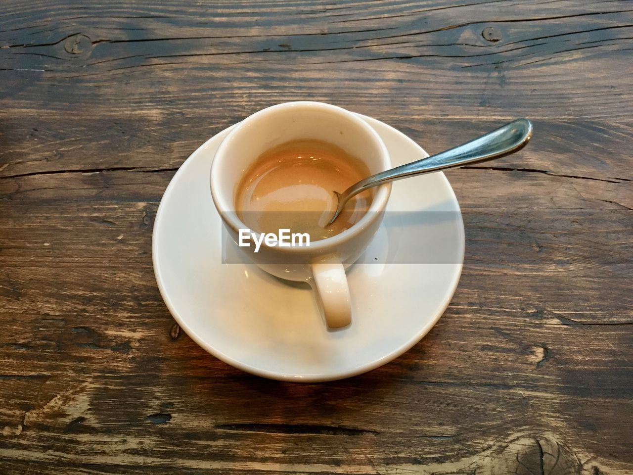 drink, table, refreshment, food and drink, cup, coffee, spoon, coffee - drink, wood - material, mug, kitchen utensil, saucer, coffee cup, eating utensil, crockery, still life, high angle view, freshness, no people, indoors, tea cup, wood grain, non-alcoholic beverage, teaspoon