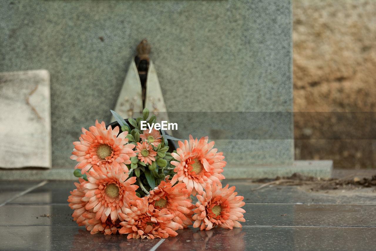 Orange Flowers At Cemetery