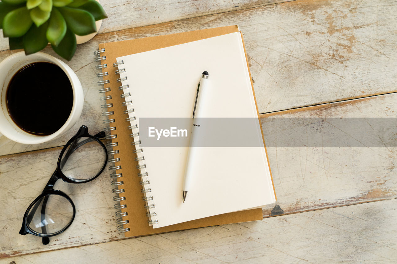 still life, publication, book, paper, directly above, indoors, table, pencil, high angle view, no people, coffee cup, cup, education, note pad, mug, open, coffee, coffee - drink, pen, spiral notebook, blank