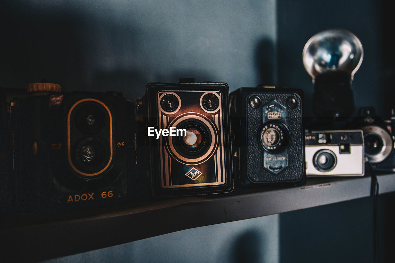 technology, indoors, close-up, retro styled, focus on foreground, photography themes, communication, no people, camera - photographic equipment, still life, table, music, antique, camera, equipment, connection, arts culture and entertainment, nostalgia, vintage, digital camera