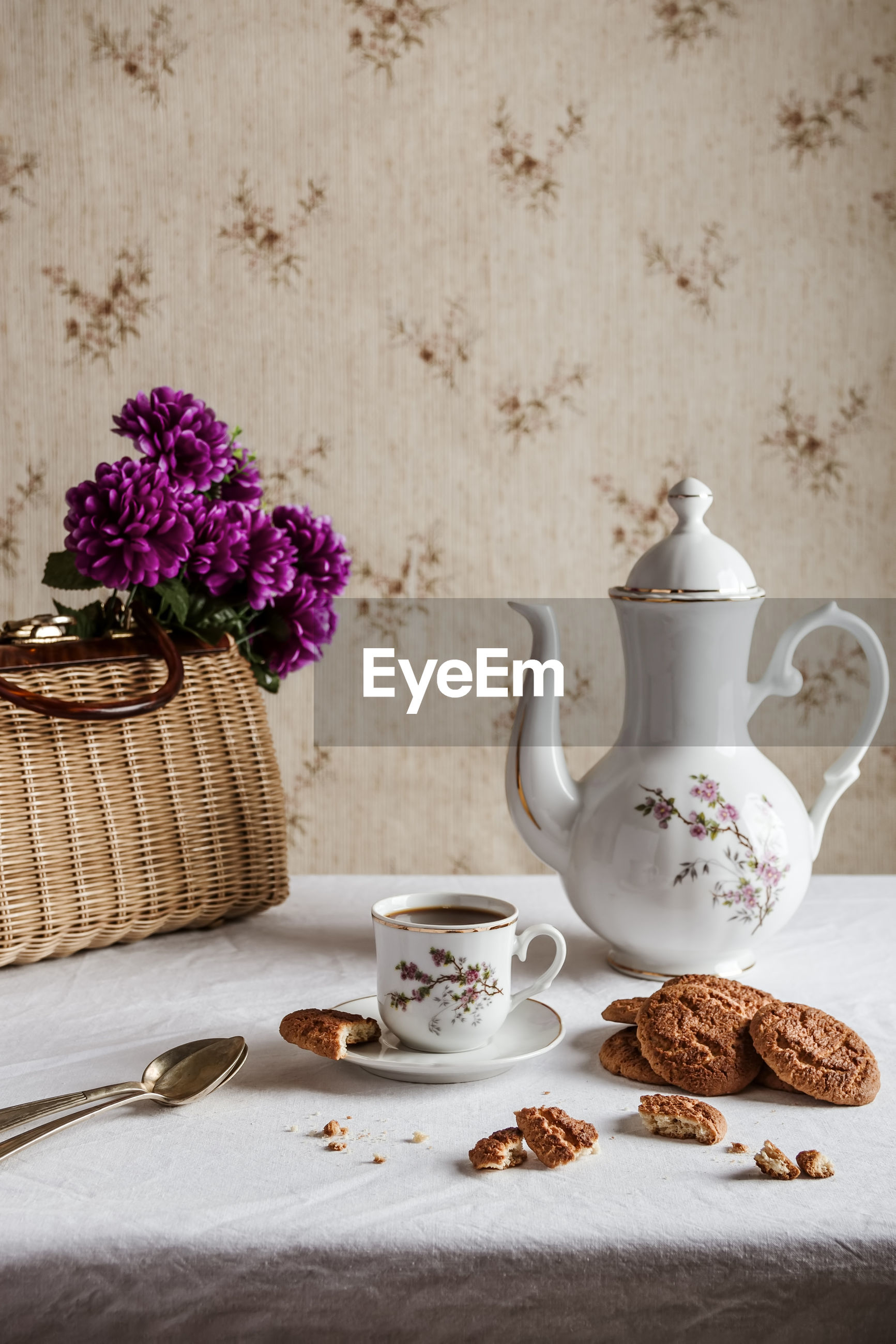 CLOSE-UP OF TEA CUP ON WHITE TABLE