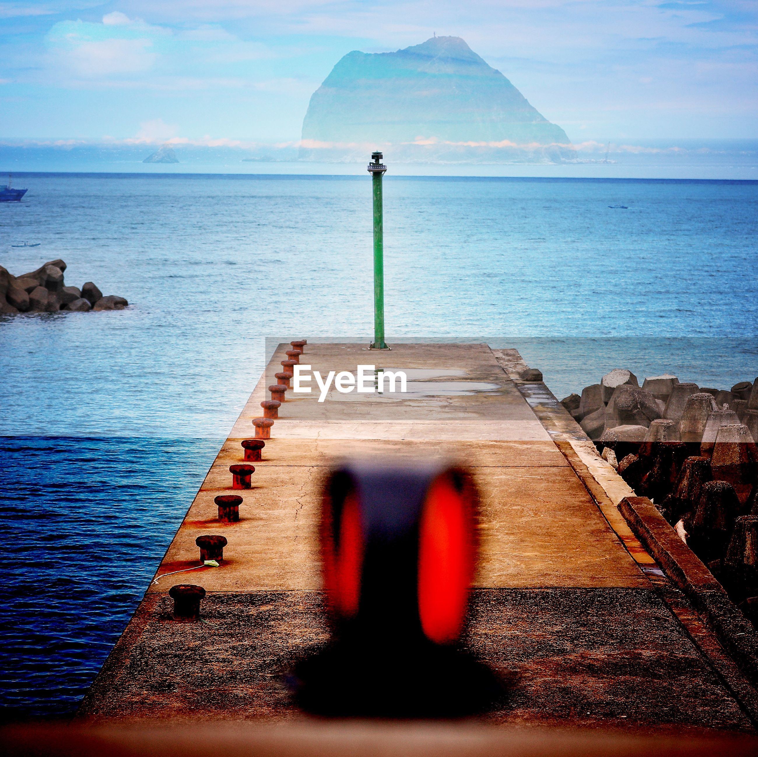 Blurred motion of equipment on pier at beach