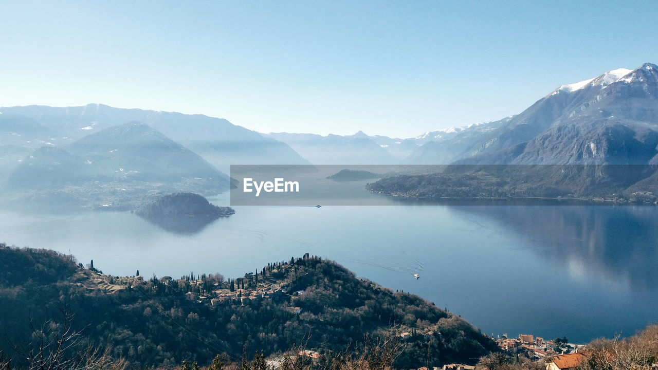 mountain, beauty in nature, scenics - nature, water, sky, tranquil scene, tranquility, environment, mountain range, nature, landscape, day, no people, lake, outdoors, idyllic, cold temperature, non-urban scene, mountain peak