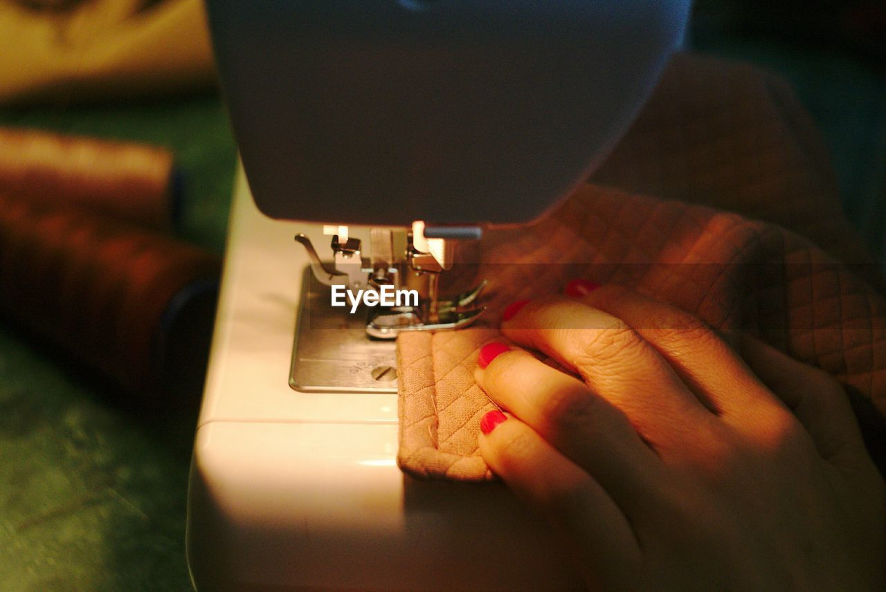 Cropped Hand Of Woman Sewing Fabric