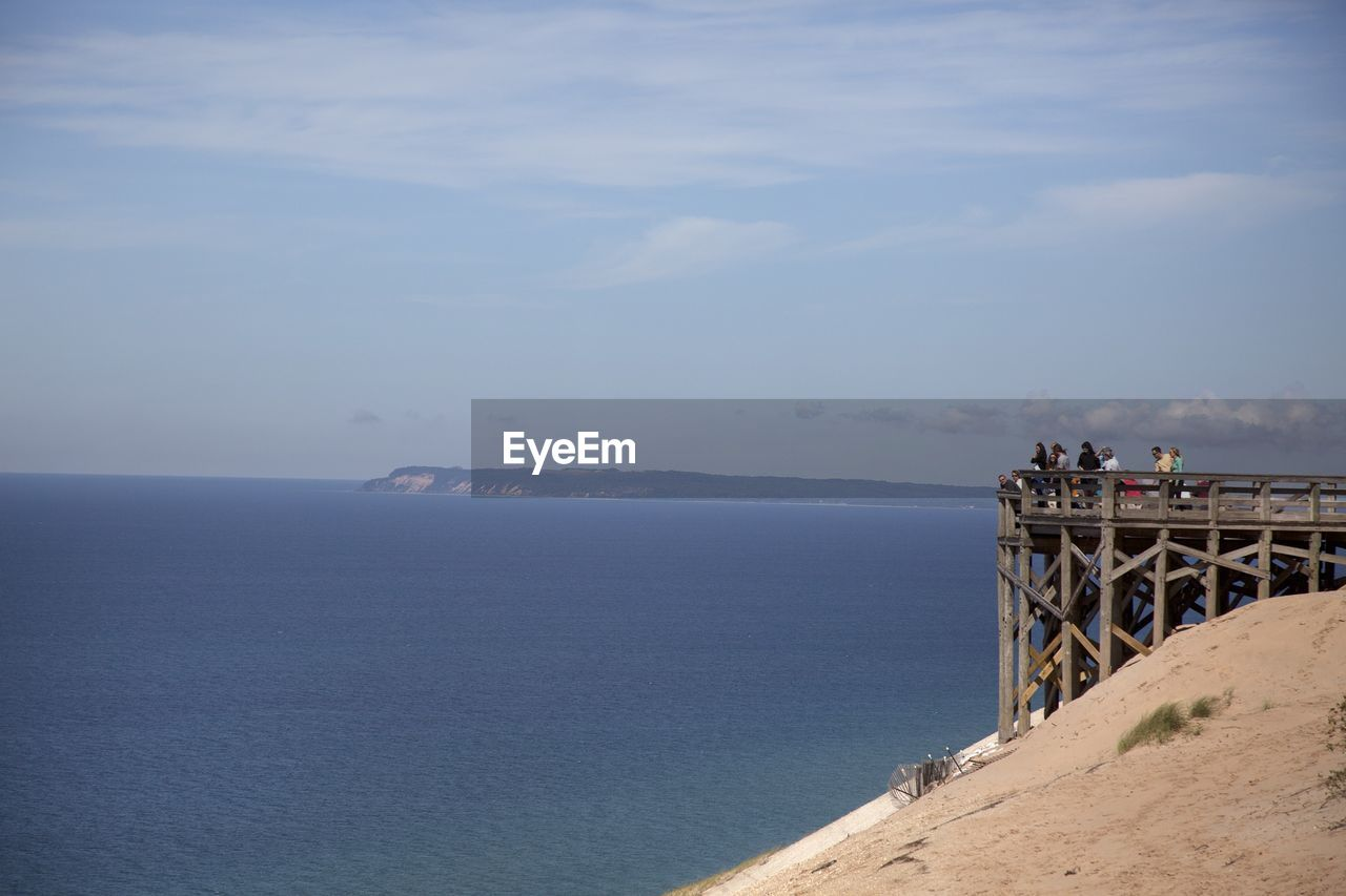 Scenic view of shore and sea against sky