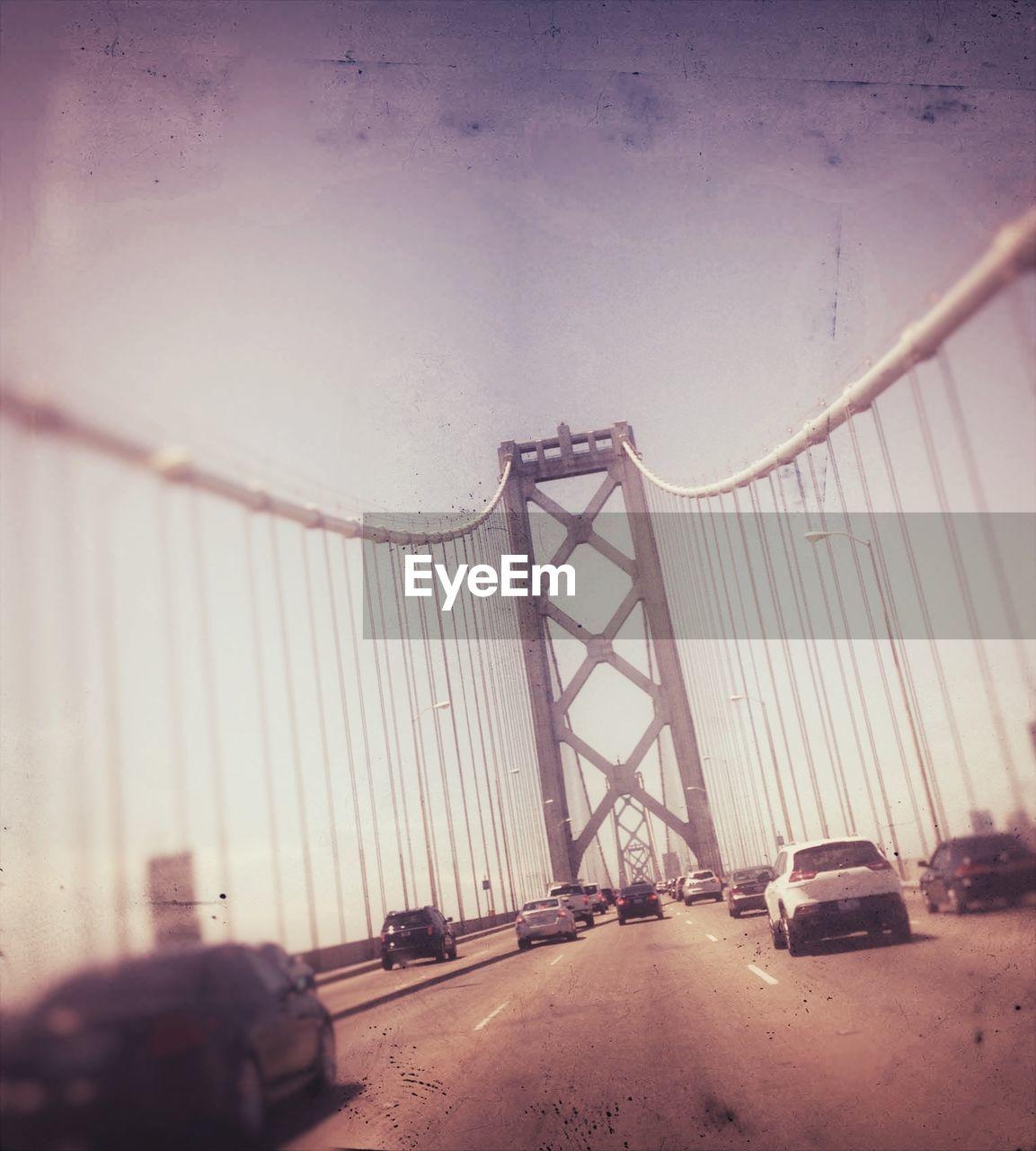 Tilt Image Of Vehicles On Bridge Against Sky