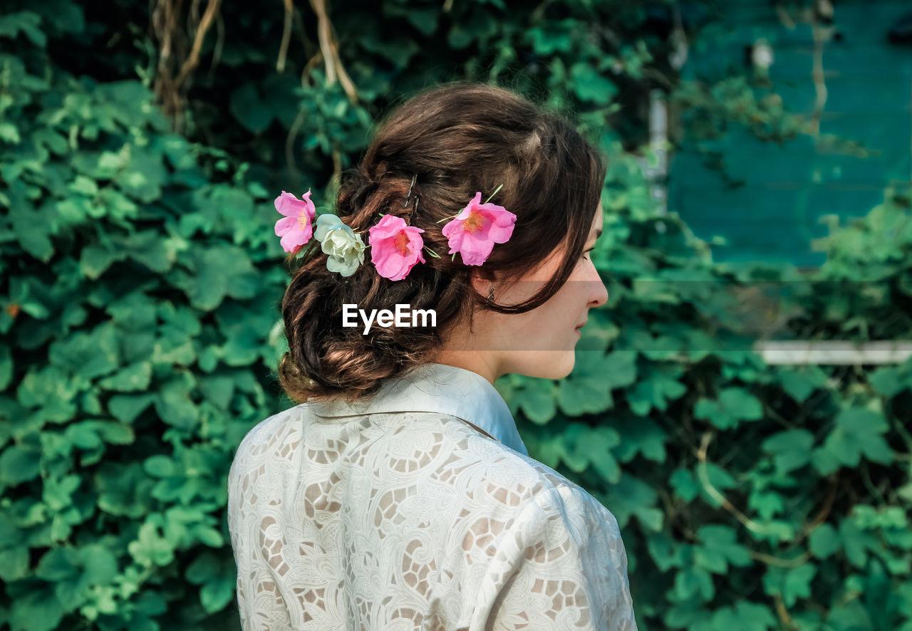 Rear view of woman wearing flowers