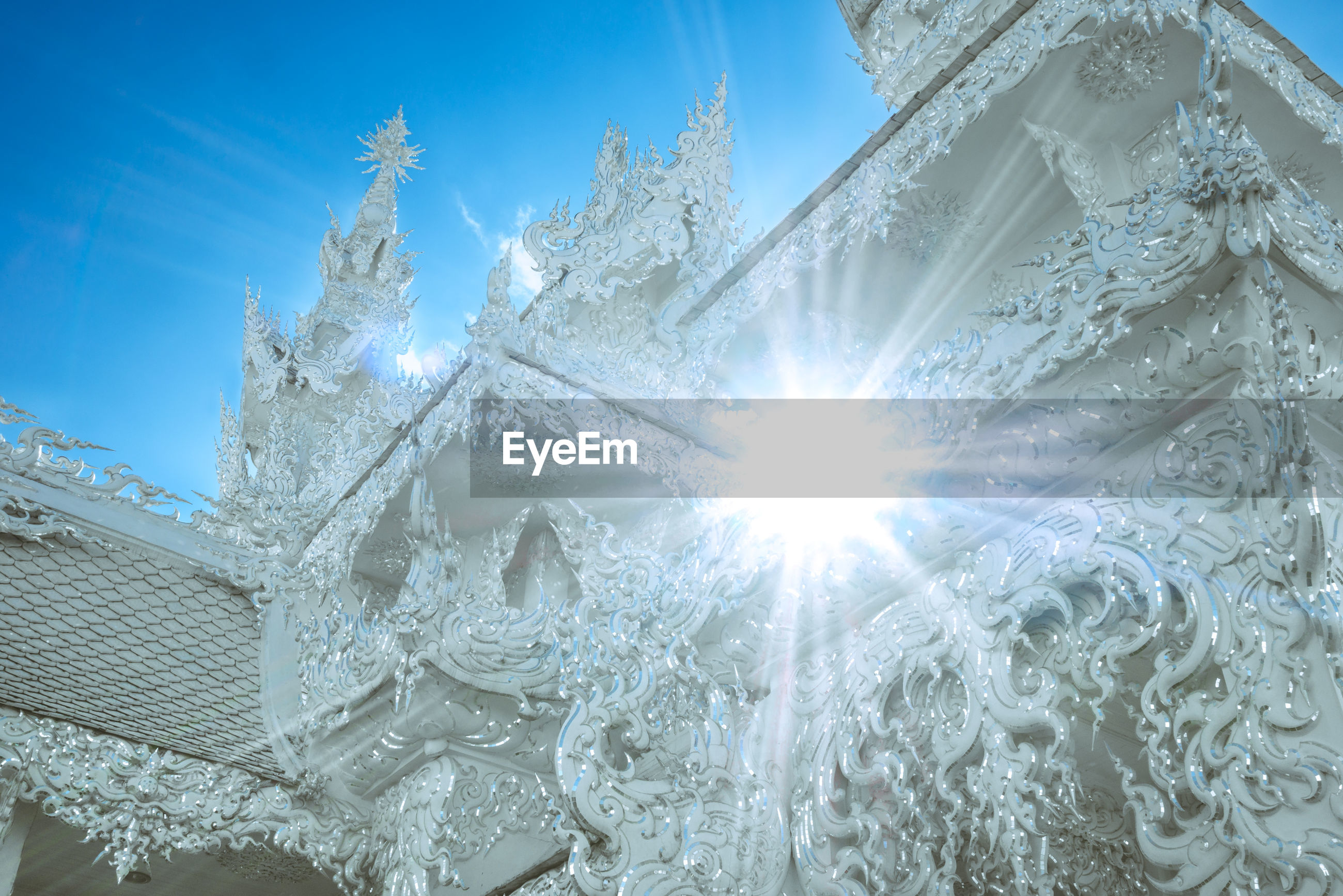 LOW ANGLE VIEW OF FROZEN BUILDING AGAINST SKY