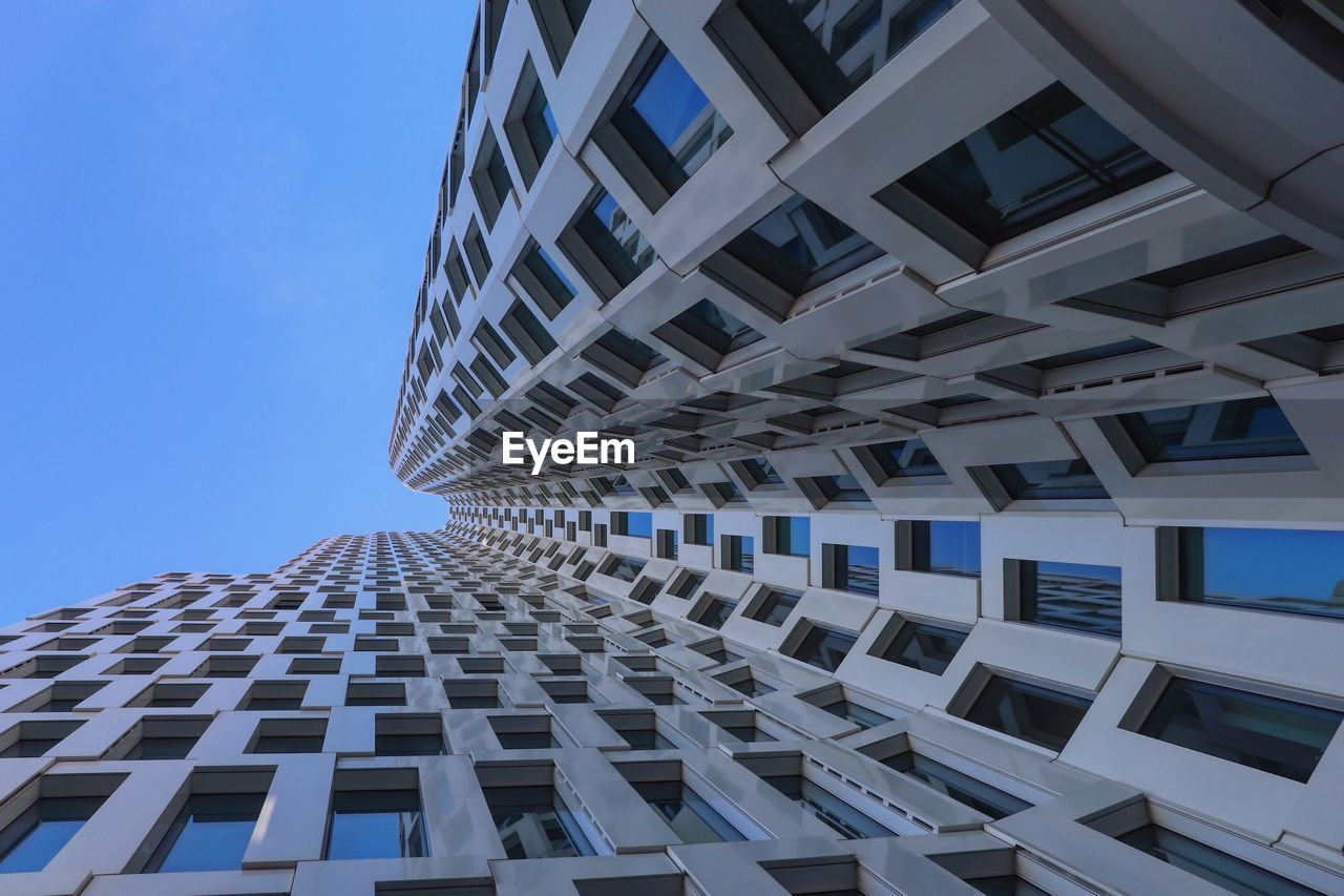 building exterior, architecture, built structure, building, low angle view, city, sky, modern, pattern, no people, day, clear sky, window, tall - high, office building exterior, nature, office, repetition, blue, outdoors, skyscraper, directly below, apartment