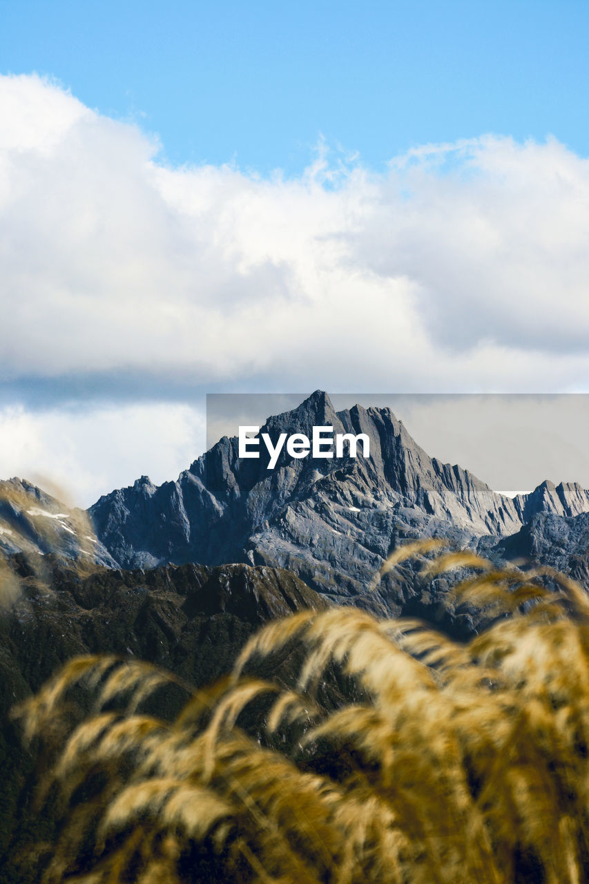 mountain, cloud - sky, scenics - nature, sky, beauty in nature, mountain range, environment, tranquil scene, landscape, tranquility, non-urban scene, nature, no people, day, snow, idyllic, remote, cold temperature, winter, snowcapped mountain, outdoors, mountain peak, formation, mountain ridge, range