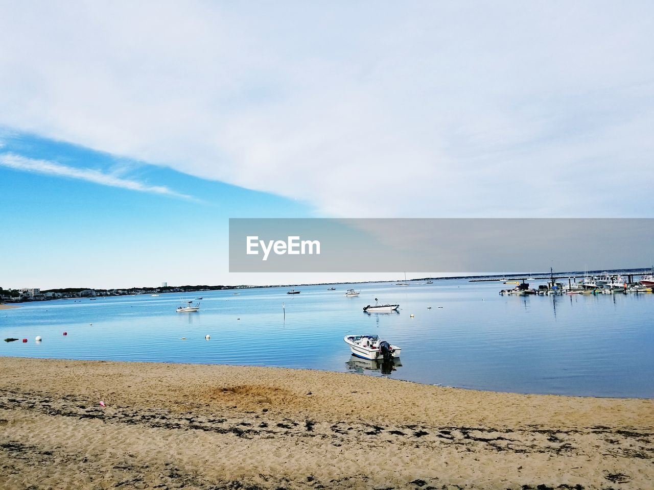 water, sky, land, beach, cloud - sky, scenics - nature, sea, beauty in nature, nature, day, real people, lifestyles, tranquil scene, non-urban scene, tranquility, sand, men, leisure activity, one person, outdoors