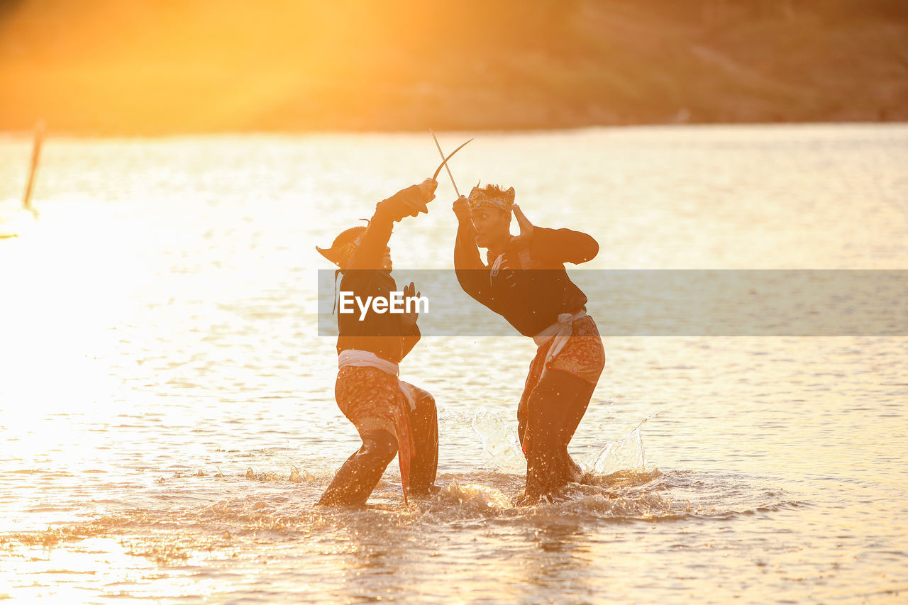 water, sea, two people, real people, togetherness, lifestyles, waterfront, sunlight, nature, leisure activity, sky, child, family, beach, land, people, silhouette, fun, beauty in nature, horizon over water, outdoors, sister
