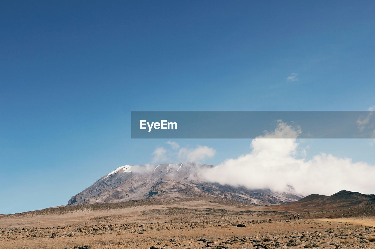 Barren Landscape With Mountain Against Sky