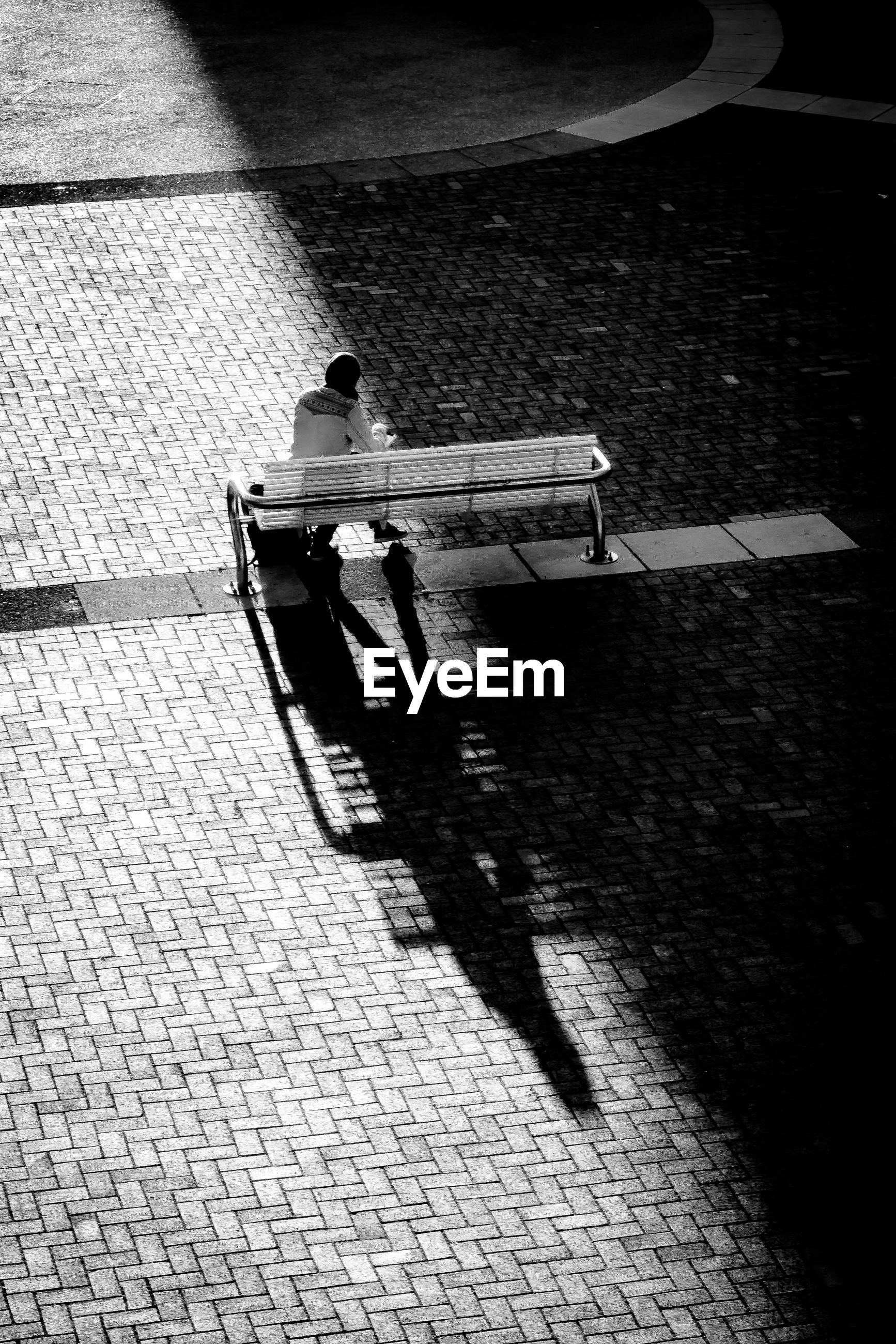 HIGH ANGLE VIEW OF PERSON ON SIDEWALK