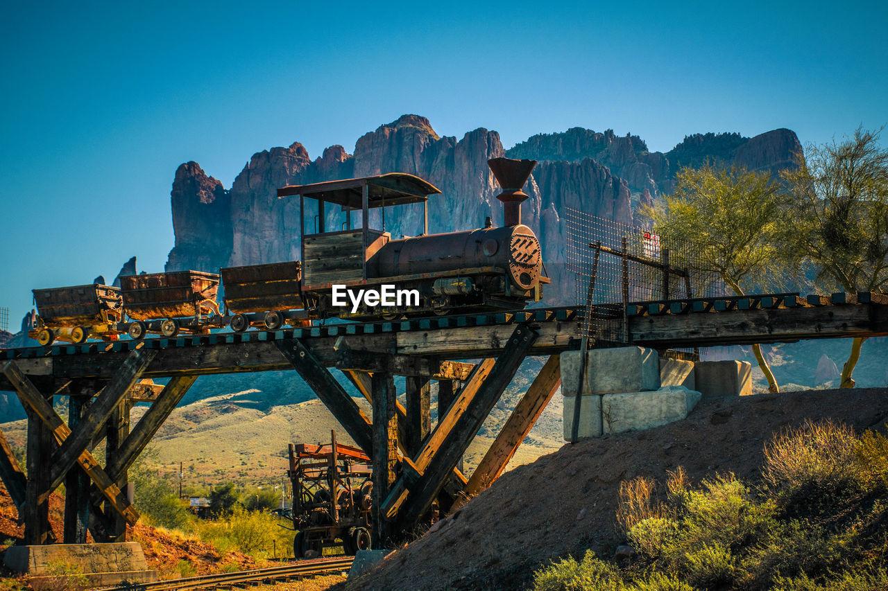 Low Angle View Of Locomotive Train On Railway Bridge