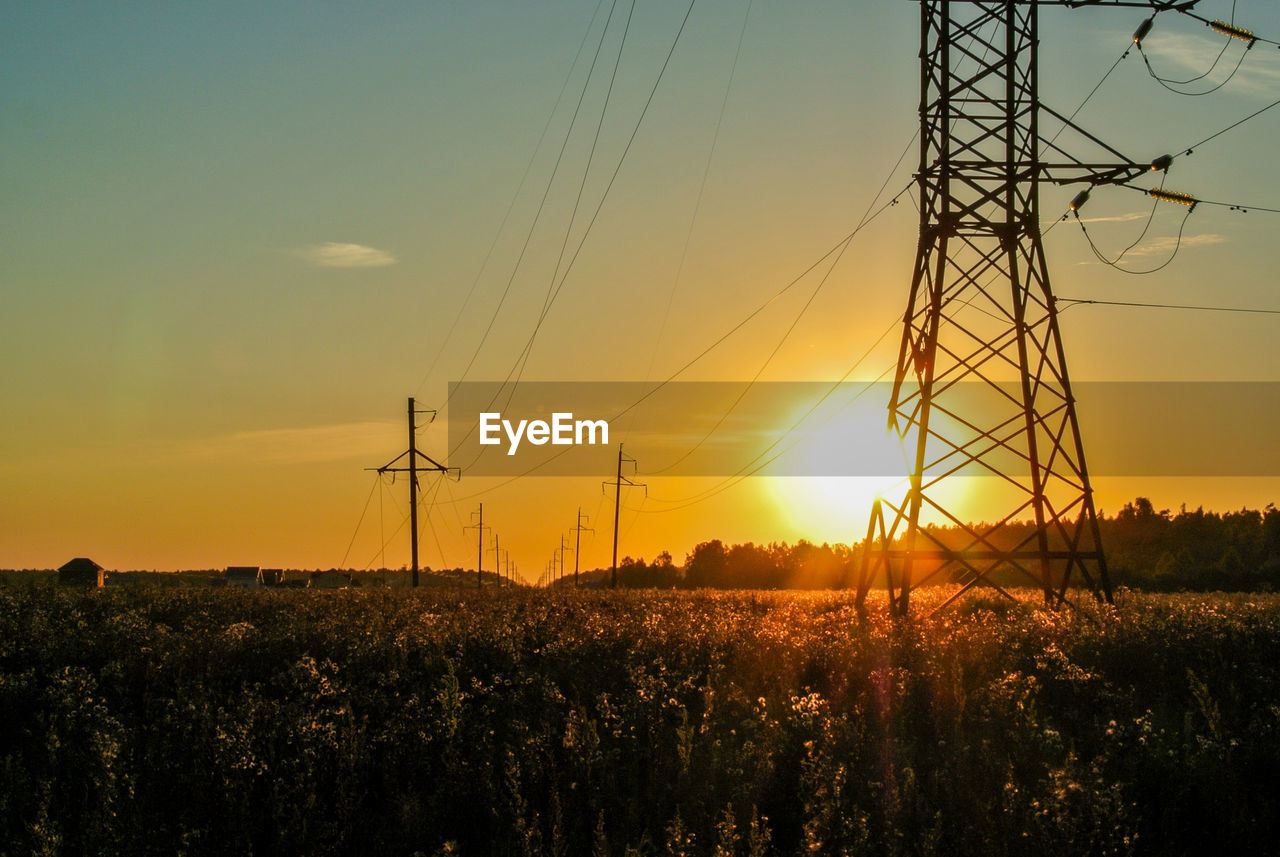 fuel and power generation, sky, sunset, electricity, technology, power supply, power line, electricity pylon, cable, orange color, connection, field, land, sun, nature, silhouette, environment, landscape, plant, beauty in nature, no people, outdoors, complexity, electrical equipment