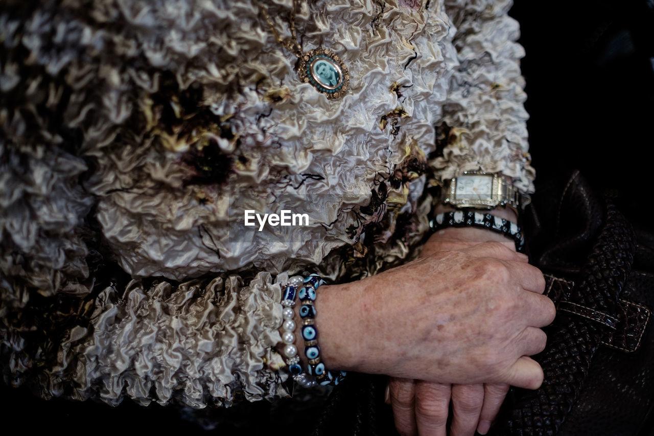Midsection Of Woman Wearing Evil Eye Beads Bracelet