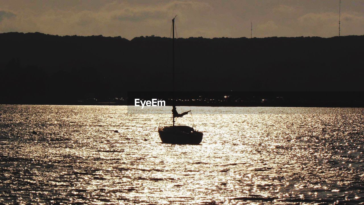silhouette, water, nature, waterfront, sea, outdoors, sky, sunset, no people, scenics, beauty in nature, nautical vessel, day