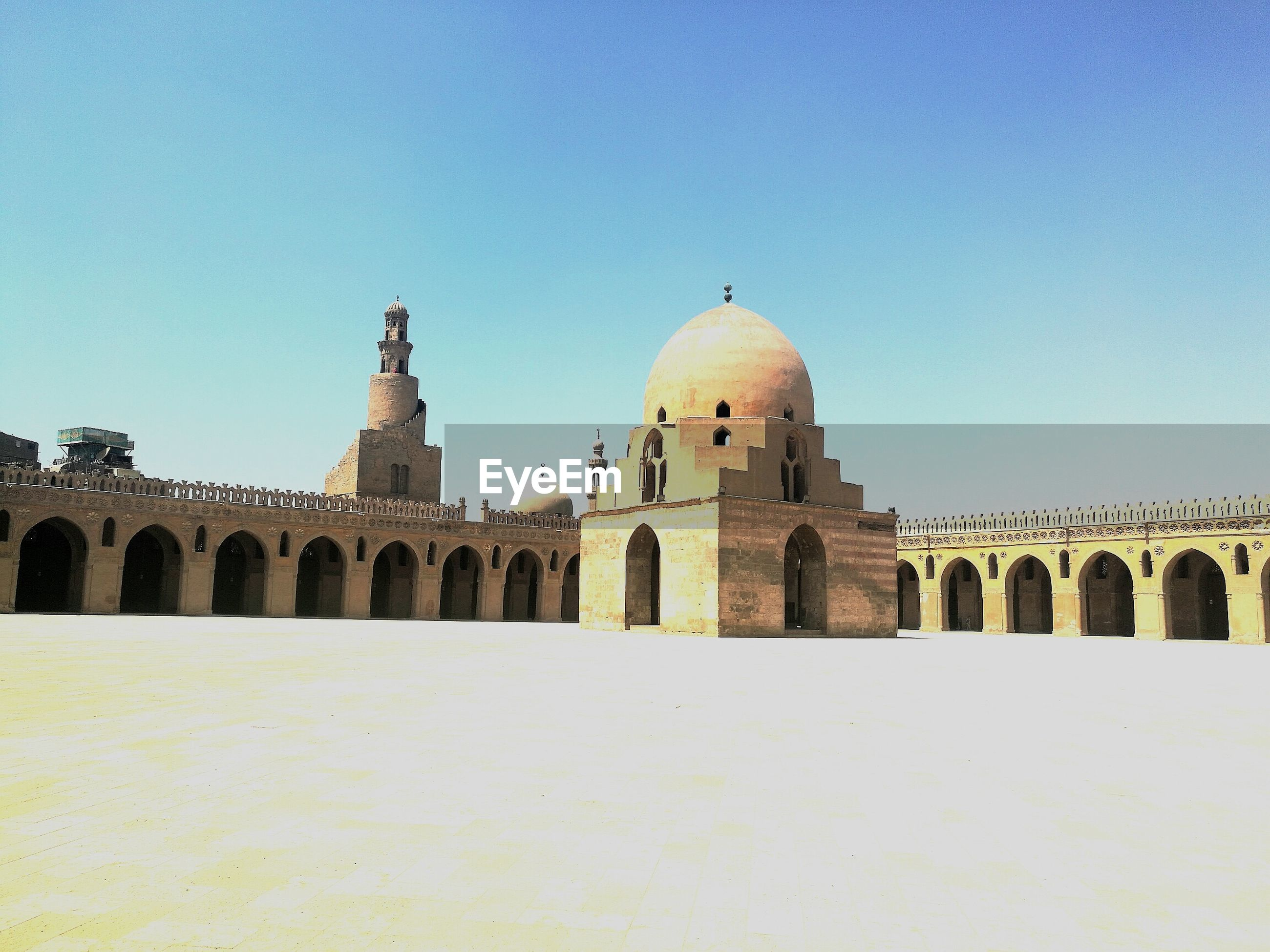 Mosque against clear blue sky