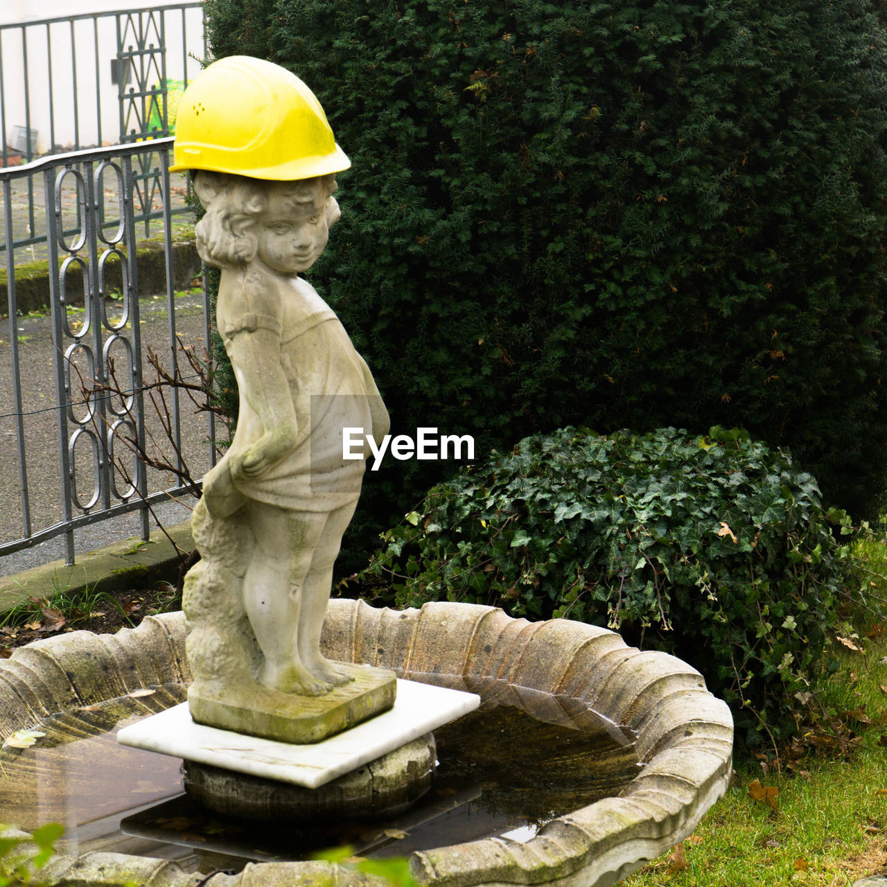 Side View Of Statue Against Plants
