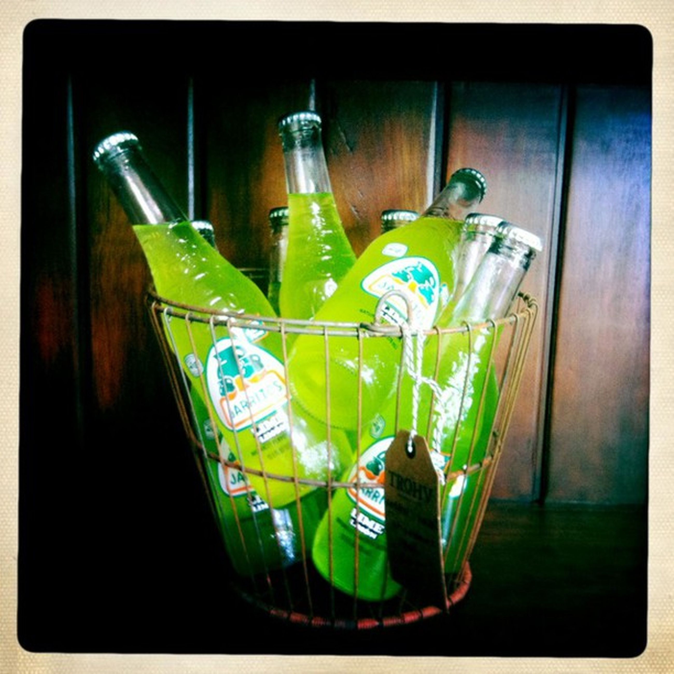 indoors, transfer print, still life, auto post production filter, table, green color, multi colored, close-up, bottle, glass - material, no people, variation, wood - material, metal, plastic, high angle view, drink, blue, container, reflection