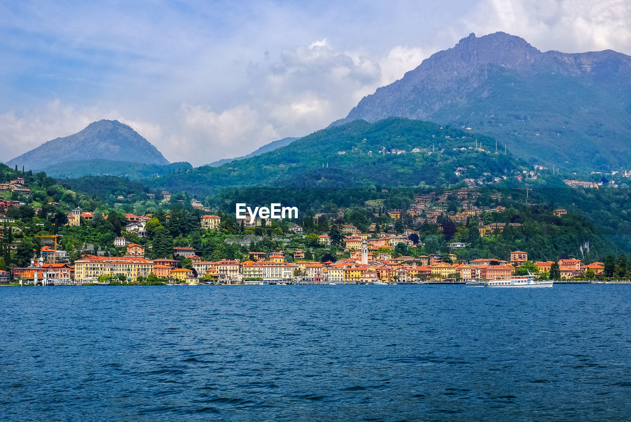mountain, water, sky, mountain range, architecture, scenics - nature, cloud - sky, beauty in nature, built structure, building exterior, waterfront, nature, no people, building, city, tree, tranquil scene, day, tranquility, outdoors, townscape, view into land