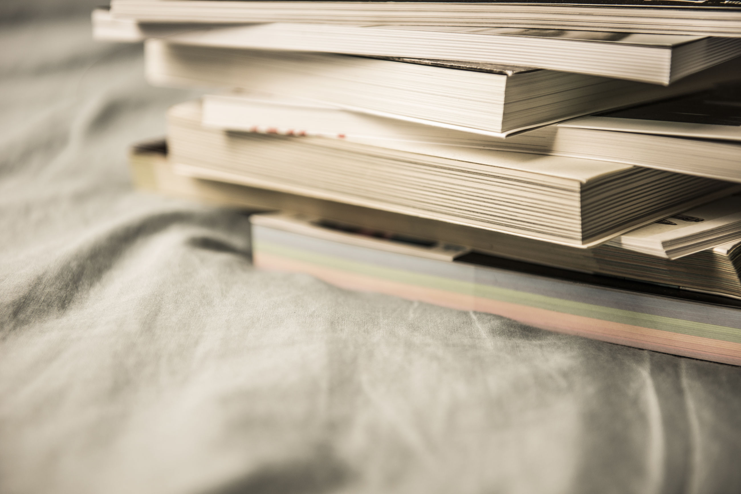 Stack of books on bed