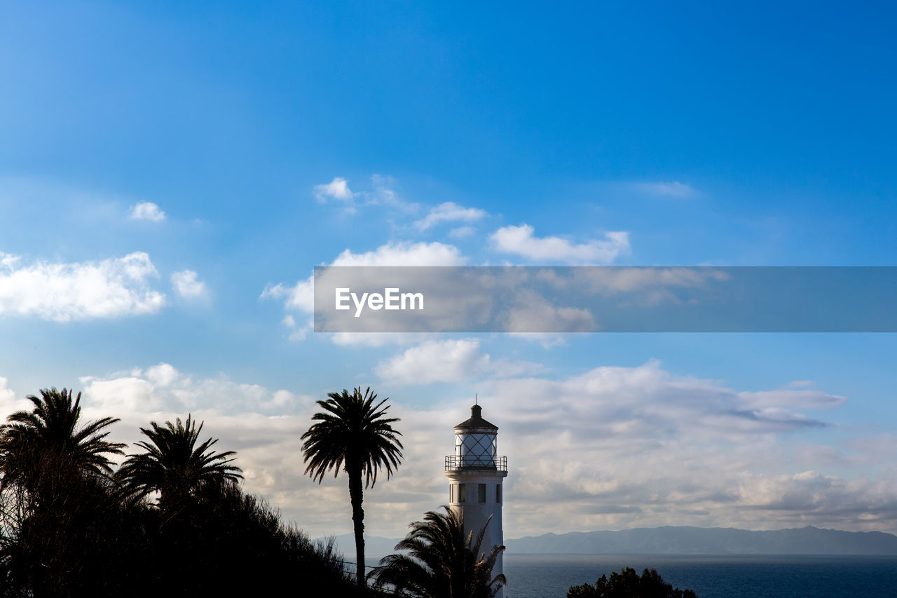 sky, cloud - sky, tree, built structure, tropical climate, palm tree, architecture, plant, building exterior, nature, no people, building, blue, scenics - nature, day, tower, beauty in nature, low angle view, outdoors, sea