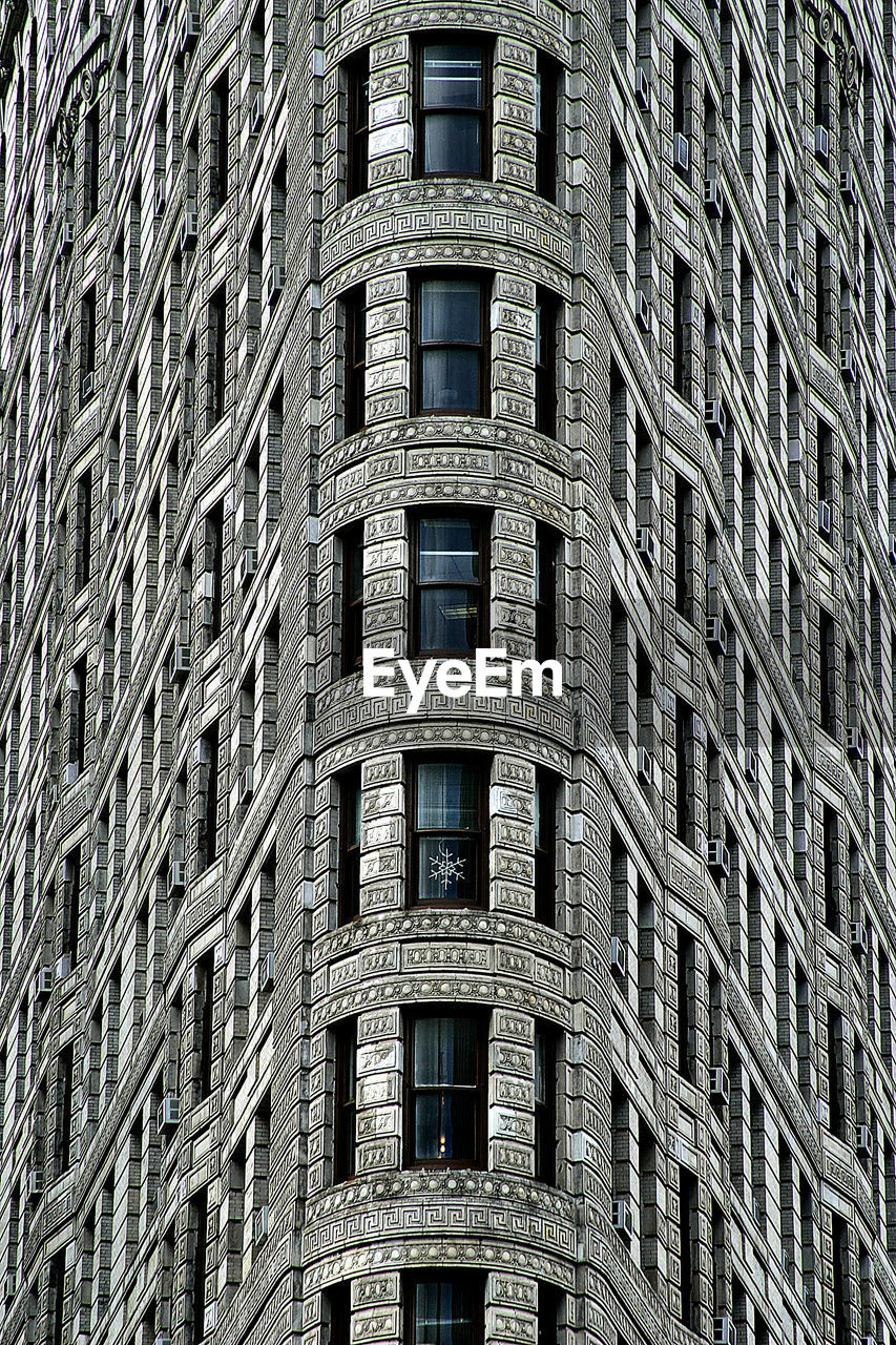full frame, built structure, architecture, building exterior, backgrounds, no people, low angle view, window, building, day, pattern, city, outdoors, repetition, nature, office building exterior, office, sunlight, in a row, industry, skyscraper, apartment
