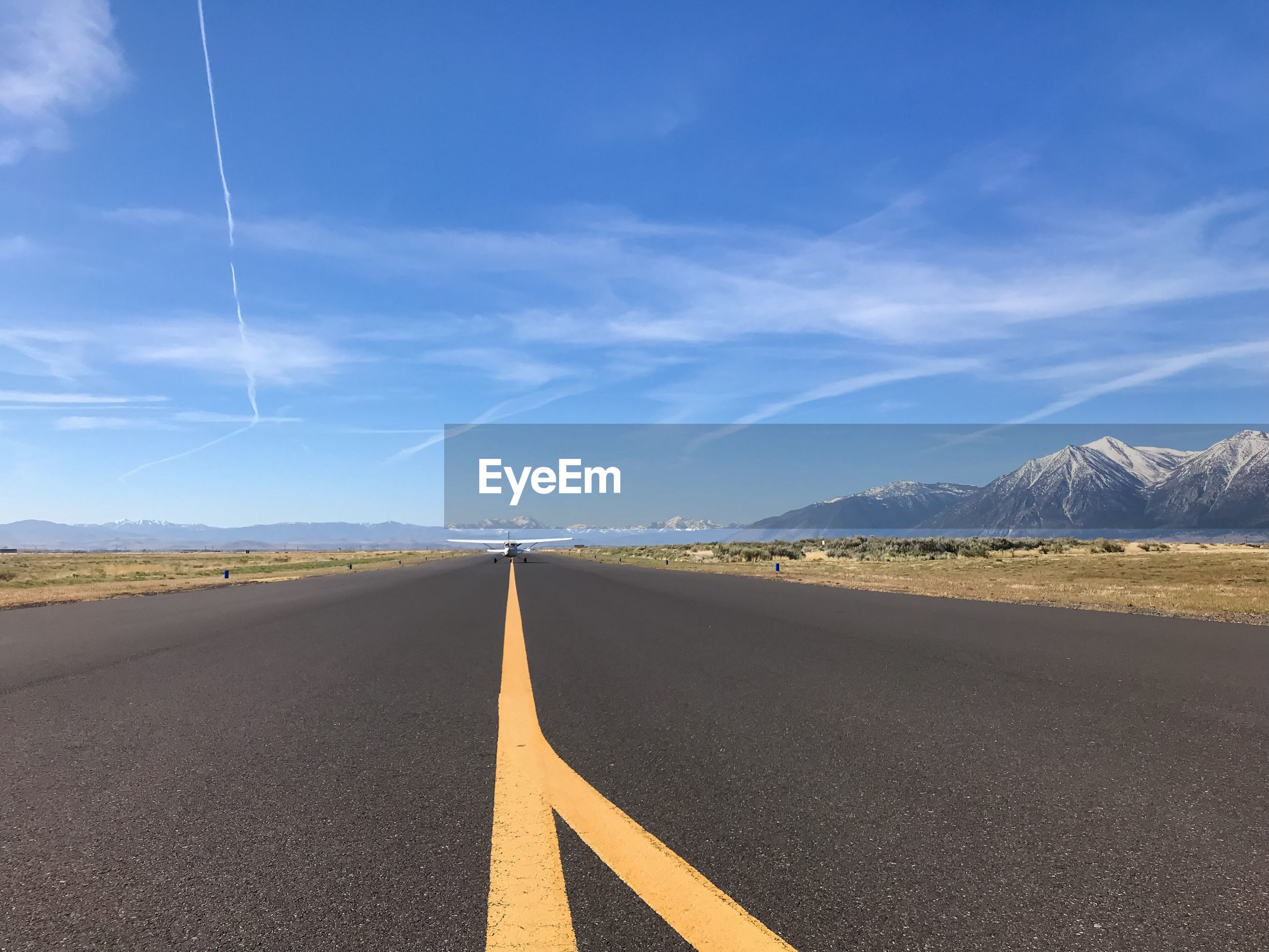 SURFACE LEVEL OF EMPTY ROAD AGAINST SKY