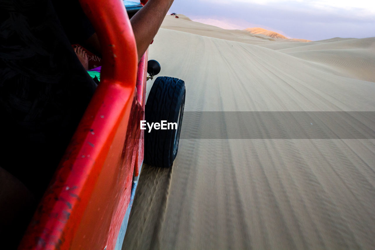 Off-Road Vehicle On Sand At Desert
