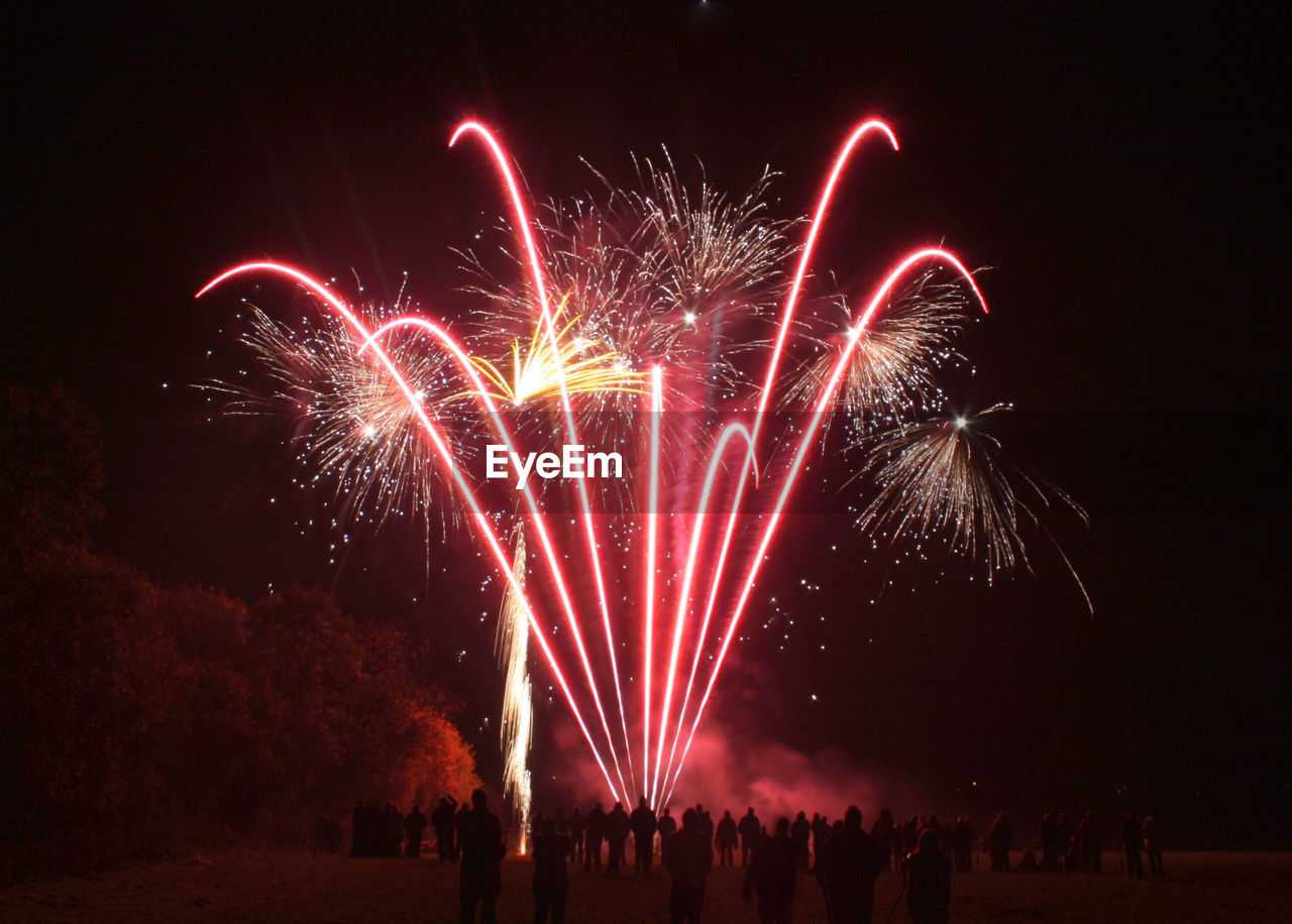 night, motion, illuminated, celebration, event, firework, arts culture and entertainment, firework display, long exposure, glowing, exploding, nature, blurred motion, firework - man made object, light, sparks, sky, multi colored, outdoors, low angle view