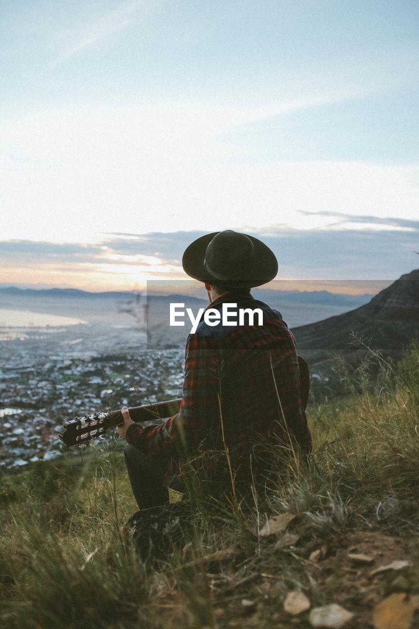 Man Playing Guitar On Mountain