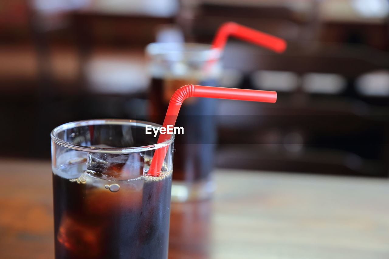 Close-up of drinks served on table at cafe