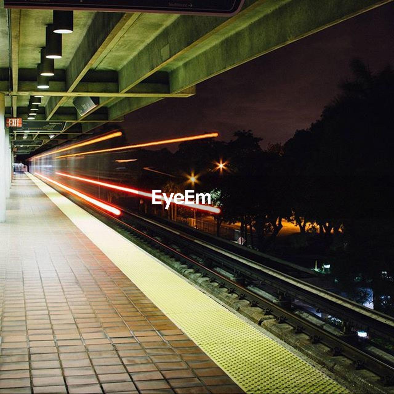 illuminated, railroad track, transportation, night, rail transportation, railroad station platform, railroad station, public transportation, no people, indoors, subway train, architecture, tree, city