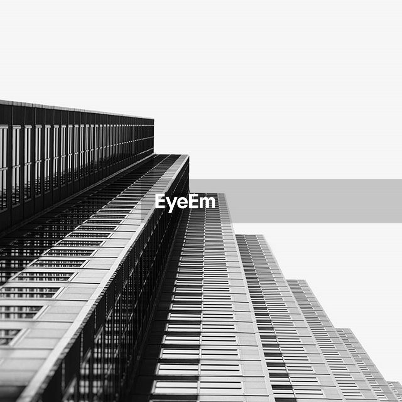 architecture, modern, building exterior, city, skyscraper, built structure, low angle view, outdoors, growth, no people, day, sky