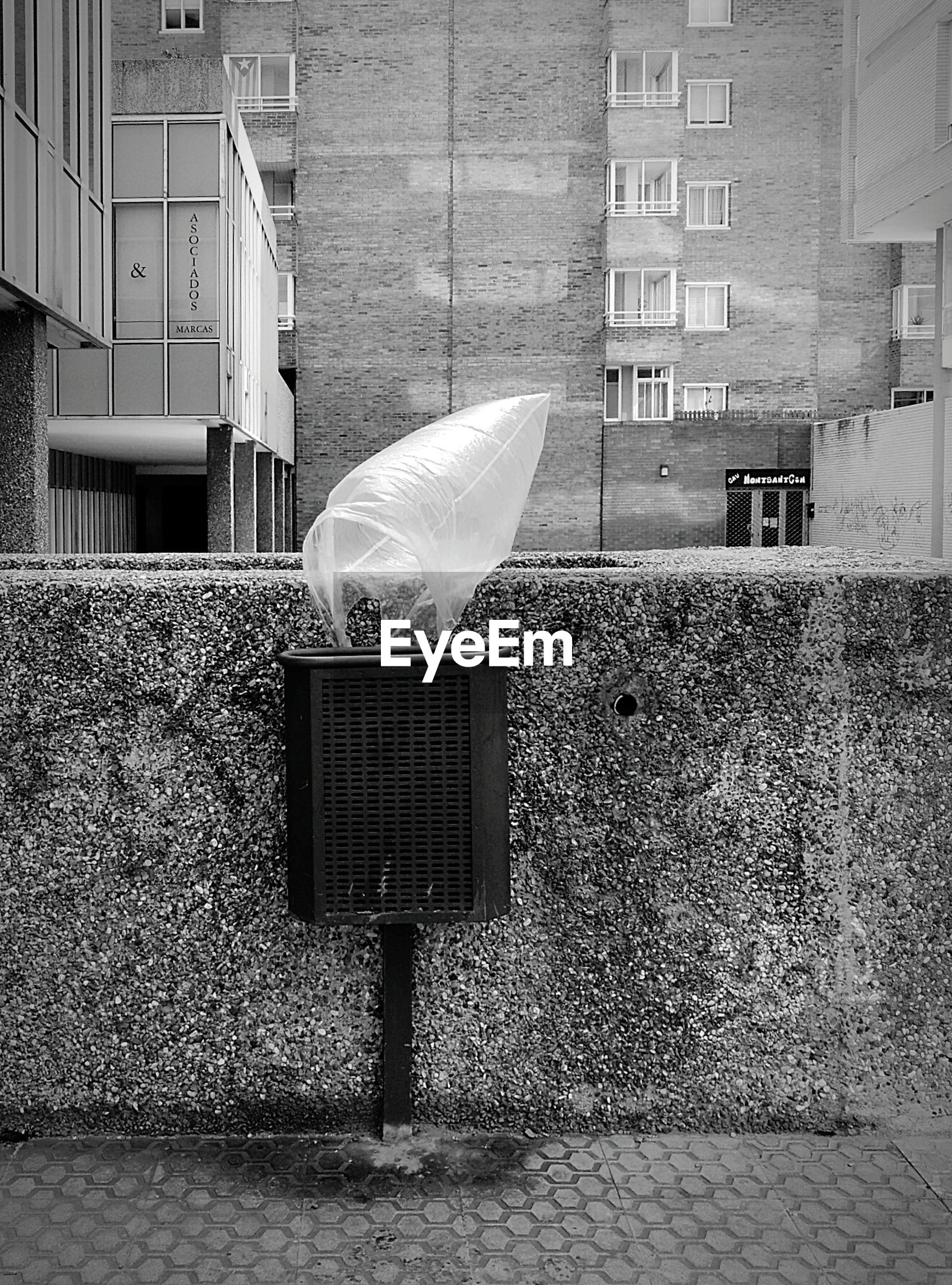Plastic bag blowing against buildings