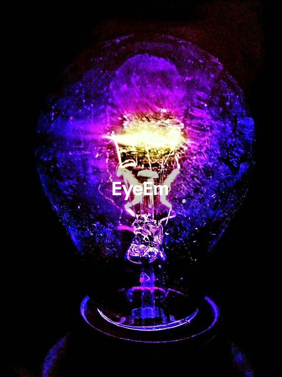 electricity, lighting equipment, light bulb, illuminated, glowing, filament, fuel and power generation, purple, technology, close-up, indoors, no people, black background, futuristic