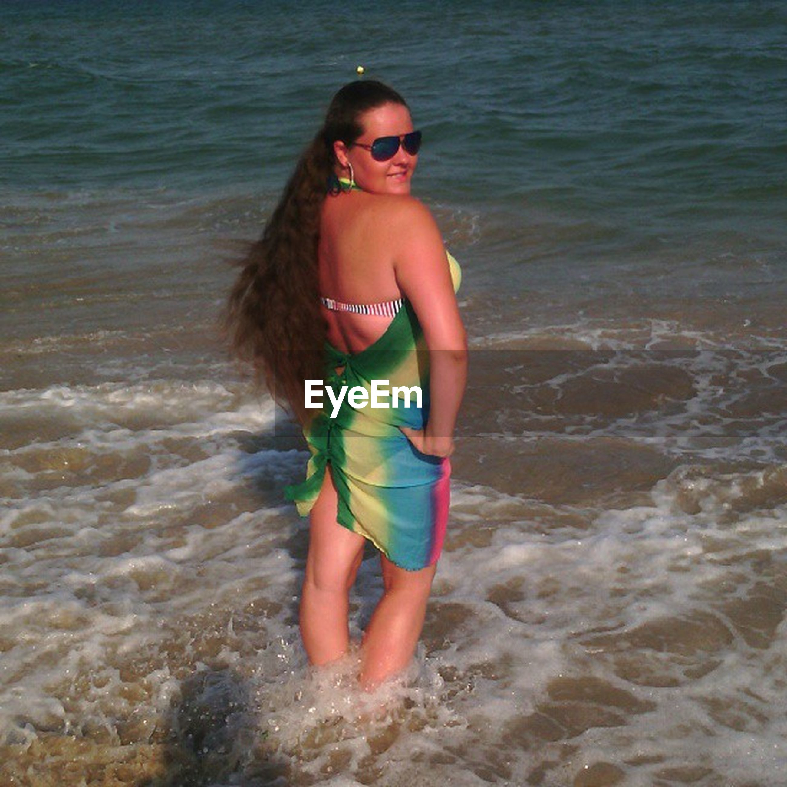 water, beach, sea, person, lifestyles, leisure activity, shore, young adult, sand, vacations, wave, young women, full length, childhood, portrait, looking at camera, happiness, enjoyment
