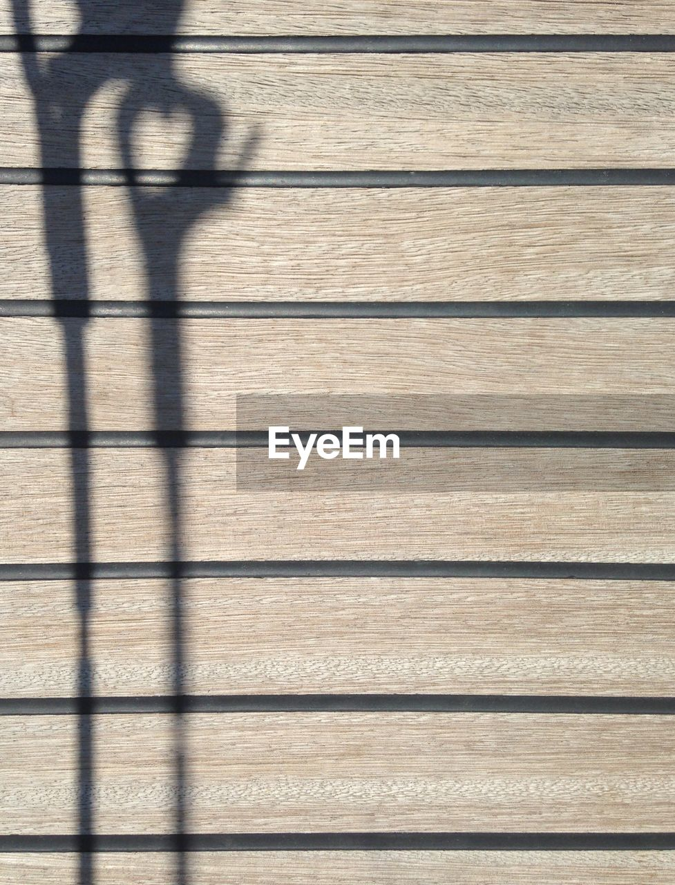 shadow, focus on shadow, sunlight, pattern, day, high angle view, real people, lifestyles, outdoors, low section, one person, nature, people, only men