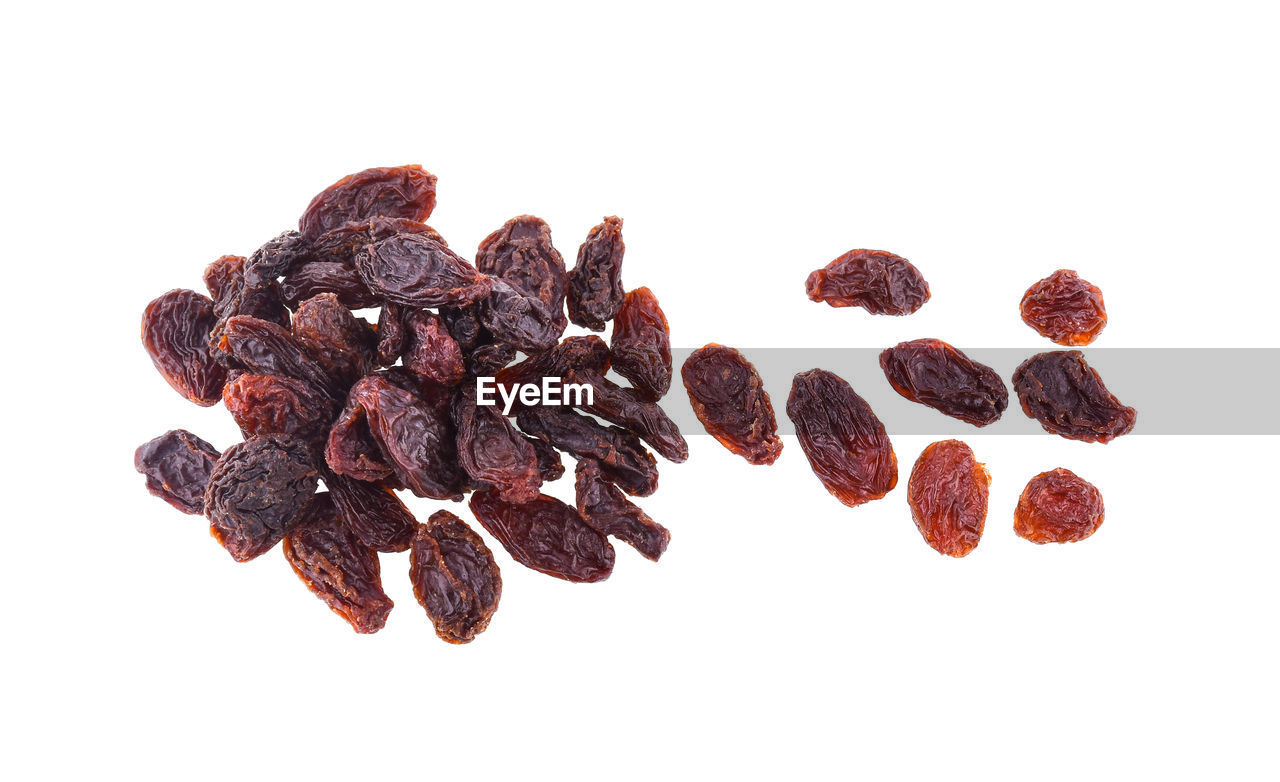 white background, studio shot, food and drink, indoors, food, still life, close-up, freshness, no people, large group of objects, group of objects, dried food, brown, cut out, group, heap, raisin, dried fruit, fruit, wellbeing, snack