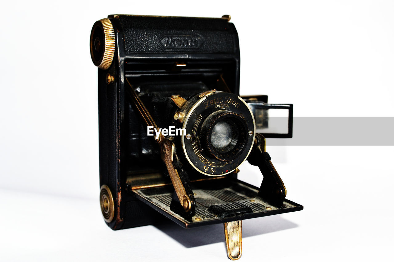 Close-Up Of Antique Camera Against White Background