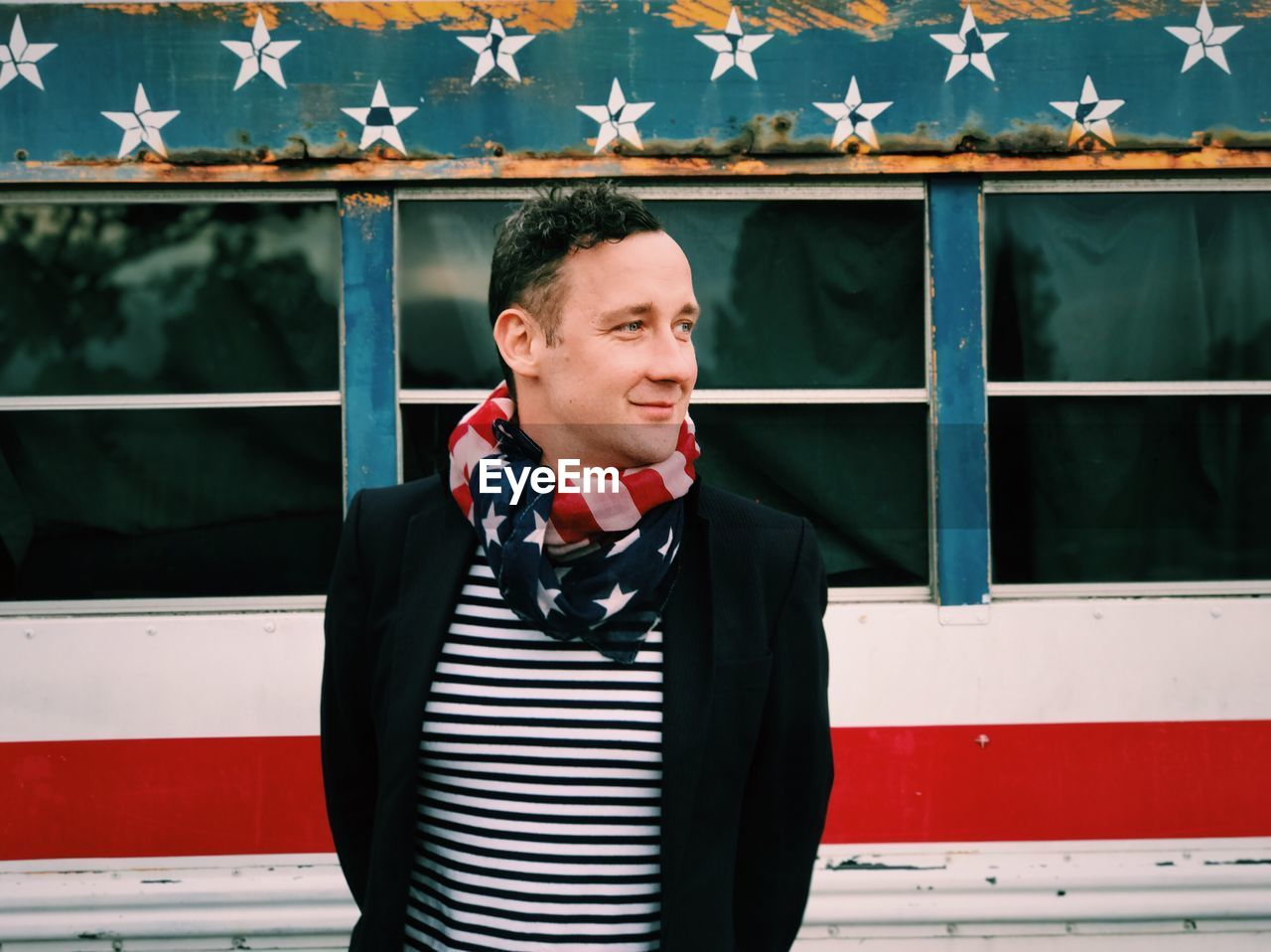 Portrait Of Man Wearing American Flag As Scarf