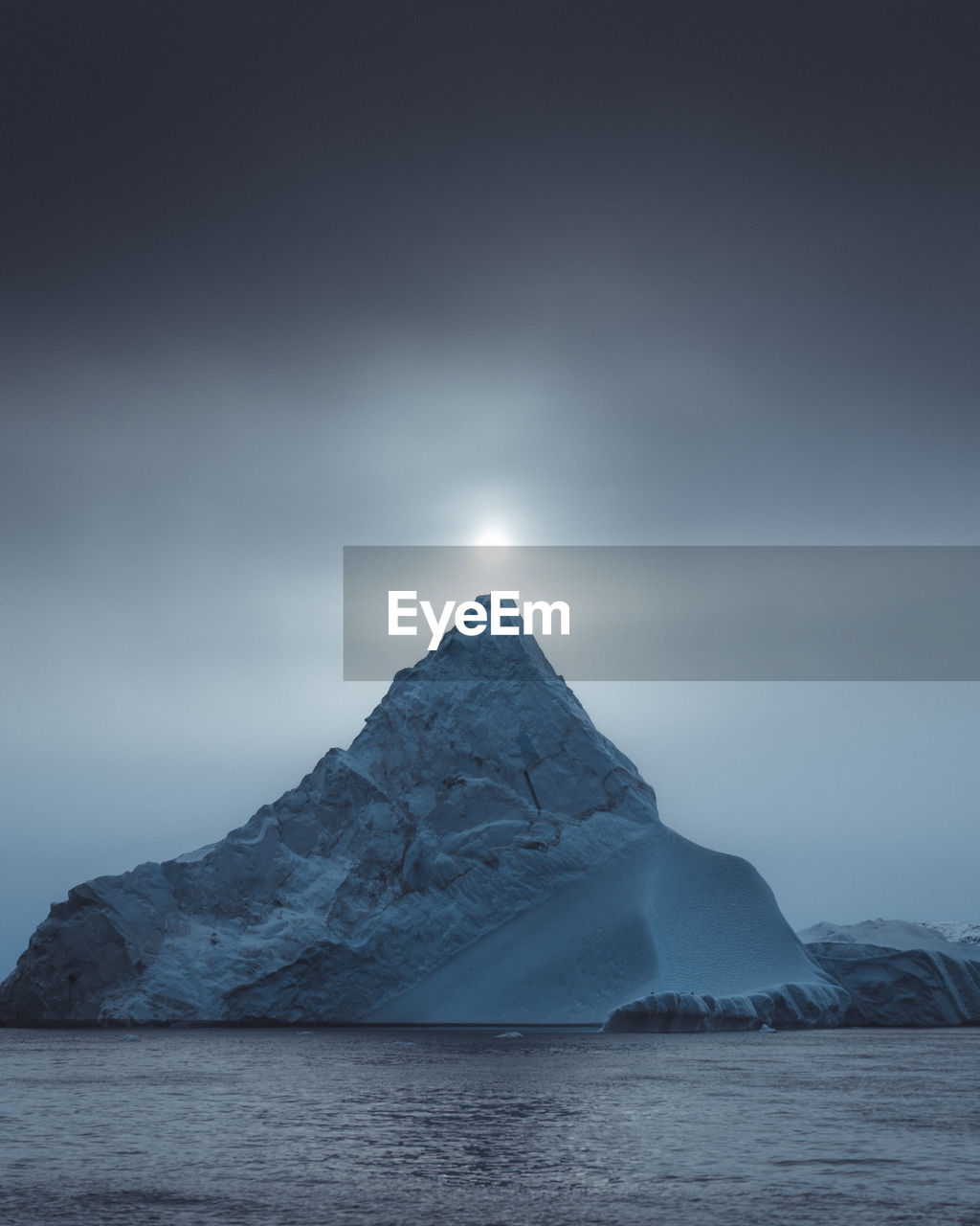 Scenic view of snowcapped mountain against sky at night